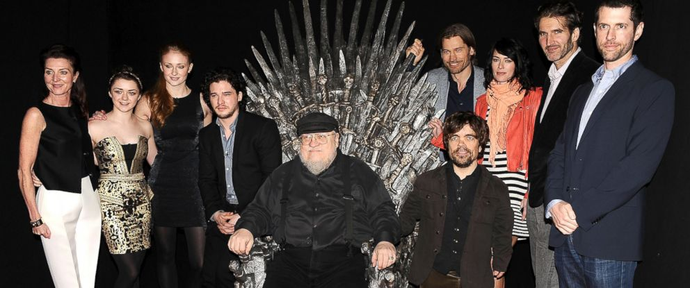 "PHOTO: George R.R. Martin, center, with the cast and producers of ""Game of Thrones."""