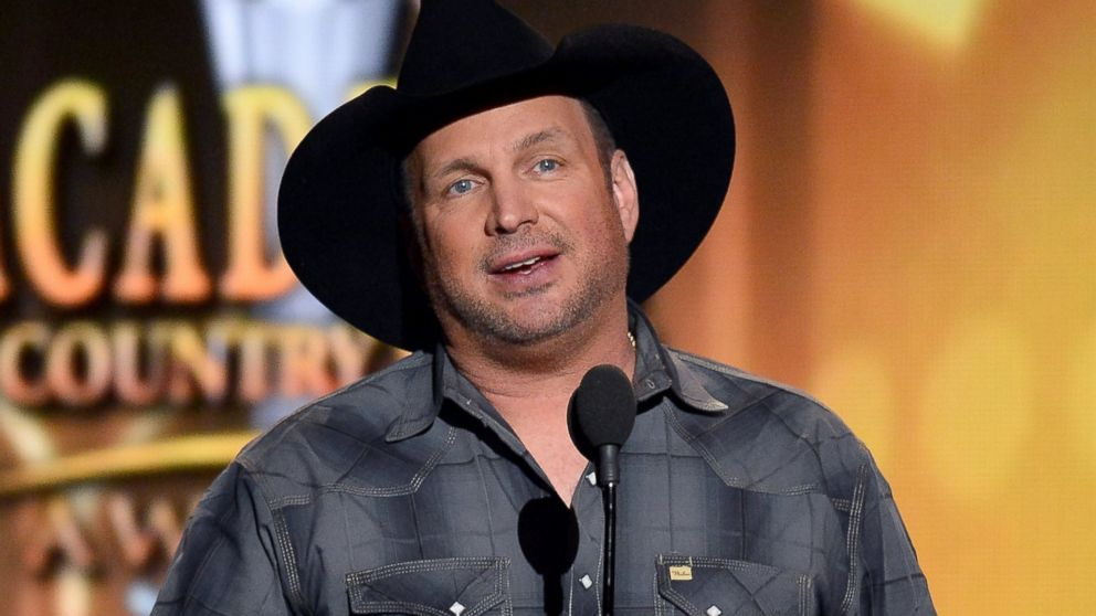 PHOTO: Recording artist Garth Brooks speaks onstage during the 49th Annual Academy of Country Music Awards at the MGM Grand Garden Arena, April 6, 2014, in Las Vegas.