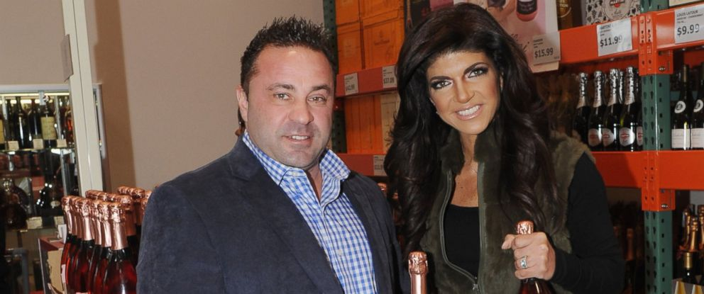 PHOTO: Joe Giudice, left, and Teresa Giudice, right, attend the Fabellini bottle signing and tasting at Costco on March 1, 2014 in Plainfield, N.J.