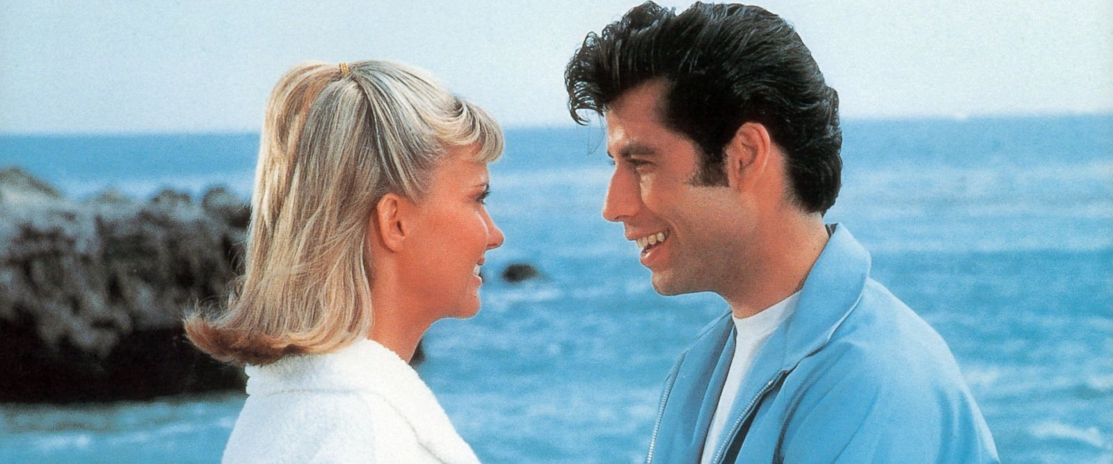 "PHOTO: Olivia Newton-John and John Travolta on the beach in a scene from the film ""Grease"", 1978."