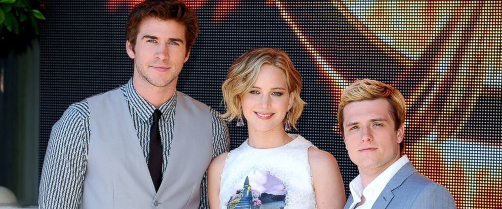 """PHOTO: Liam Hemsworth, Jennifer Lawrence and Josh Hutcherson attend """"The Hunger Games: Mockingjay Part 1"""" Photocall - at the 67th Annual Cannes Film Festival, May 17, 2014, in Cannes, France."""