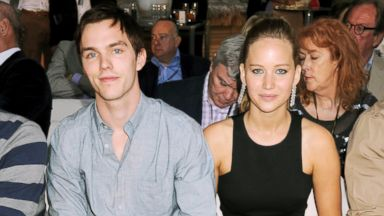 PHOTO: Nicholas Hoult and Jennifer Lawrence attend a cocktail reception during Amber Lounge Fashion Monaco 2012 at Le Meridien Beach Plaza Hotel, May 25, 2012 in Monaco.