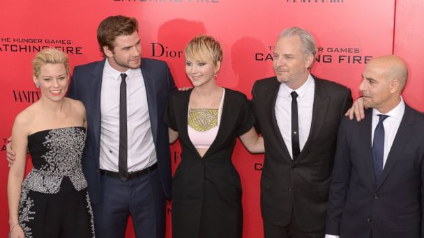 "PHOTO: Elizabeth Banks (L), Liam Hemsworth (2nd L) Jennifer Lawrence (C), director Francis Lawrence (2nd R) and Stanley Tucci (R) arrive at a special screening of ""The Hunger Games: Catching Fire"" Nov. 20, 2013 in New York."
