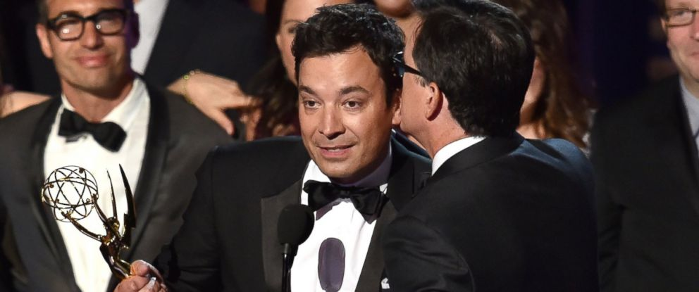 PHOTO: TV personality Stephen Colbert, right, accepts Outstanding Variety Series for The Colbert Report from TV personality Jimmy Fallon onstage at the 66th Annual Primetime Emmy Awards.