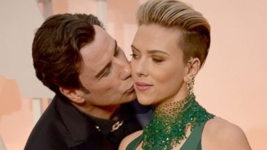 PHOTO: John Travolta, left, and Scarlett Johansson, right, are pictured on Feb. 22, 2015 in Hollywood, Calif.