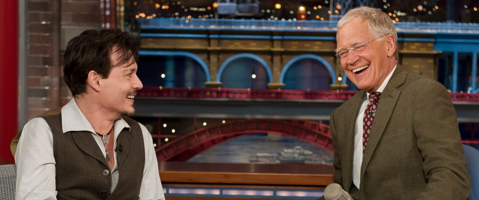 PHOTO: Johnny Depp, left, chats with David Letterman, right, on April 3, 2014 in New York City.