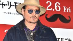 Johnny Depp Accessorizes Big Time for His Premiere