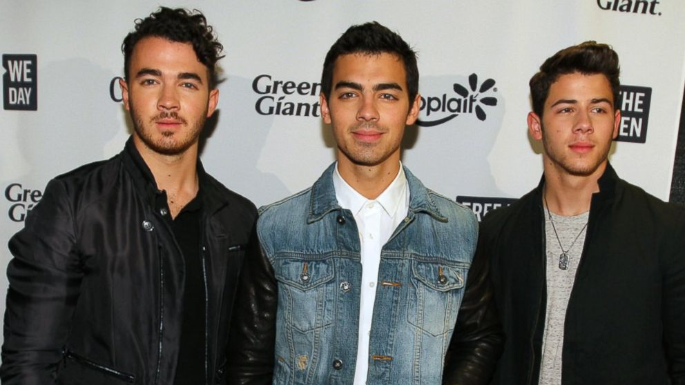 PHOTO: The Jonas brothers pose during the red carpet before the We Day Minnesota event at the Xcel Energy Center in St. Paul, Minn, Oct. 8, 2013.