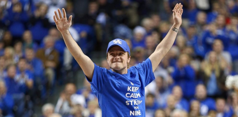PHOTO: Josh Hutcherson waves to the crowd during the Louisville Cardinals game against the Kentucky Wildcats at Rupp Arena, Dec. 28, 2013, in Lexington, Ky.