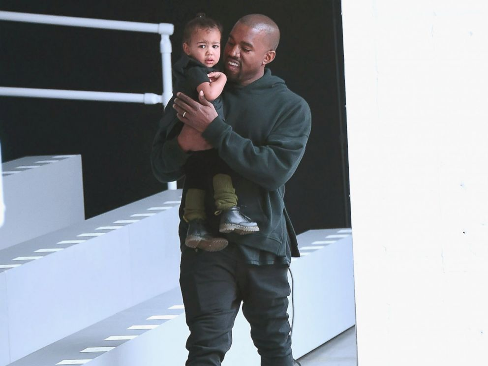 PHOTO: Kanye West and North West attend the adidas show during Mercedes-Benz Fashion Week Fall 2015 at Skylight Clarkson Sq., Feb. 12, 2015, in New York.