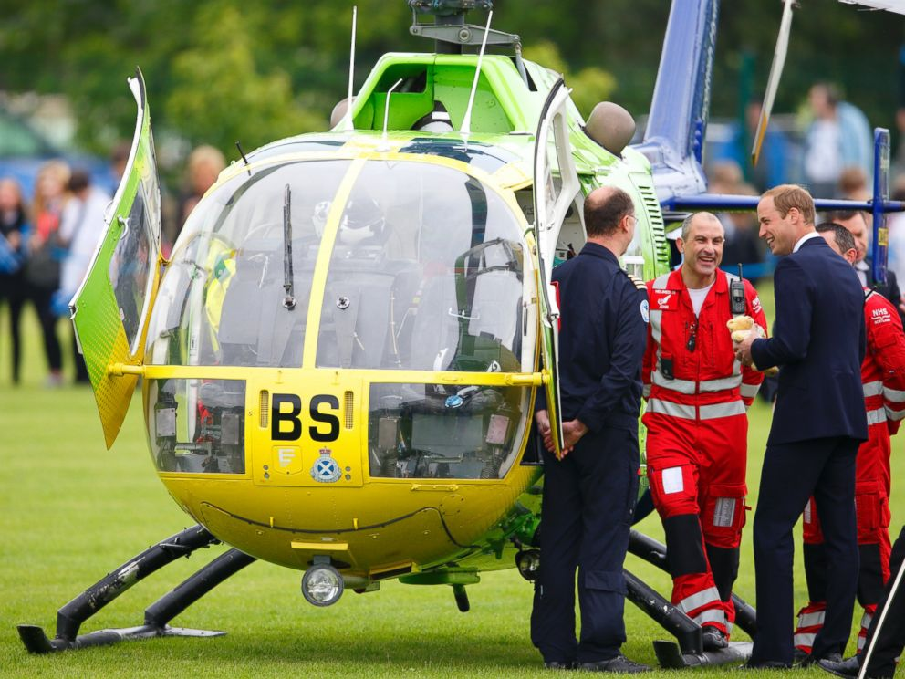 PHOTO: Prince William, Duke of Cambridge meets Air Ambulance pilots & medics as he visits Strathearn Community Campus on a day of engagements in Strathearn on May 29, 2014 in Crieff, Scotland.