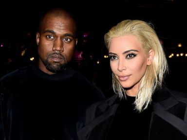PHOTO: Kanye West and Kim Kardashian attend the Balmain show as part of the Paris Fashion Week Womenswear Fall/Winter 2015/2016, March 5, 2015, in Paris.