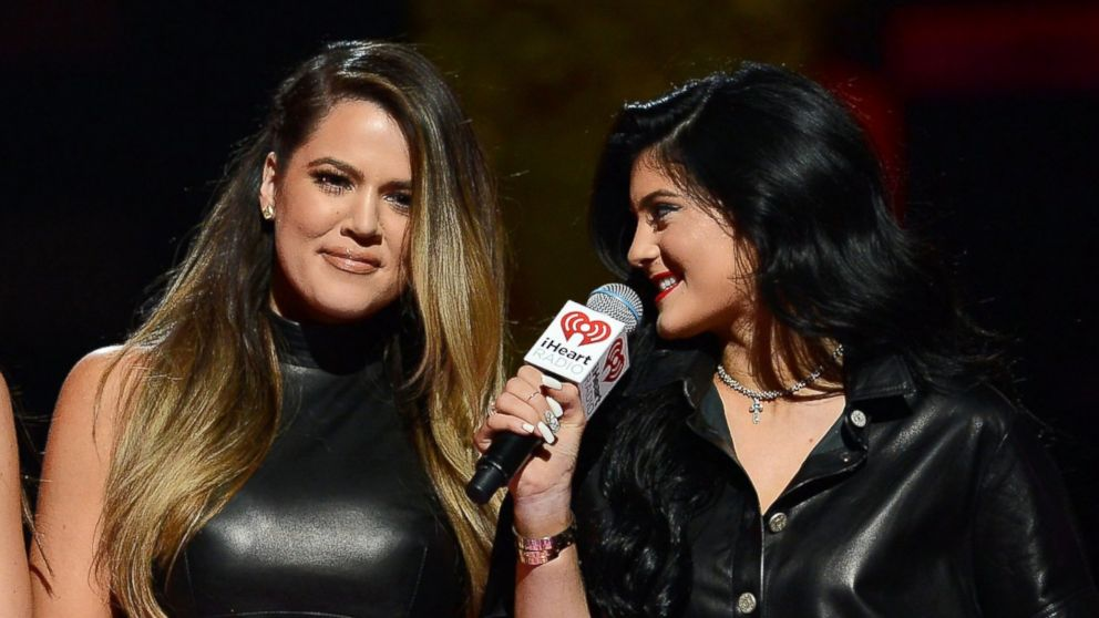 PHOTO: Khloe Kardashian and Kylie Jenner speak onstage during the iHeartRadio Music Festival at the MGM Grand Garden Arena, Sept. 21, 2013 in Las Vegas, Nev.