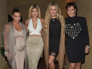 Kim Kardashian Dresses Her Bump in Gold