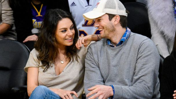 PHOTO: Mila Kunis and Ashton Kutcher attend a basketball game between the Oklahoma City Thunder and the Los Angeles Lakers at Staples Center, Dec. 19, 2014, in Los Angeles.