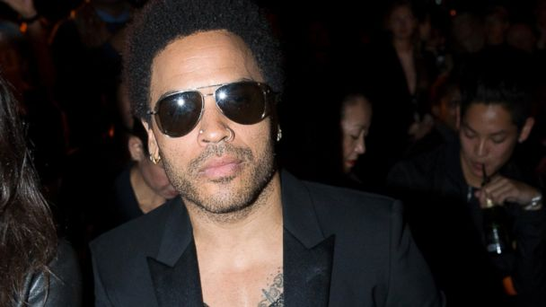 PHOTO: Lenny Kravitz attends the Saint Laurent show as part of the Paris Fashion Week Menswear Spring/Summer 2015, June 29, 2014, in Paris.