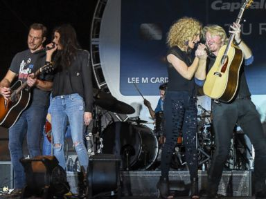 PHOTO: Members of the band Little Big Town, Jimi Westbrook, Karen Fairchild, Kimberly Schlapman and Phillip Sweet perform at the Capital One Orange Bowl, Dec. 31, 2014 in Miami Gardens, Fla.