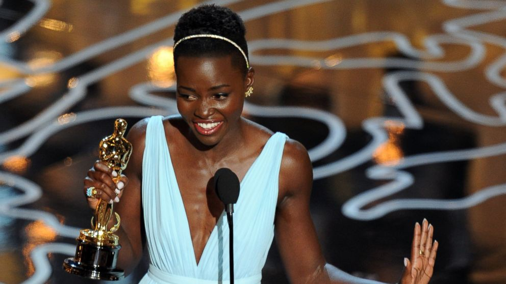 PHOTO: Lupita Nyongo accepts the Best Performance by an Actress in a Supporting Role award during the Oscars on Mar. 2, 2014 in Hollywood, Calif.