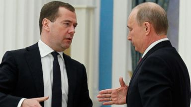 PHOTO: Russias President Vladimir Putin, shakes hands with Prime Minister Dmitry Medvedev, during the Expanded Cabinet Meeting in the Kremlin in Moscow, Jan. 31, 2013.