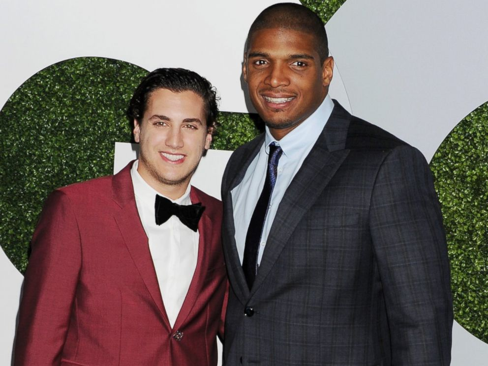 PHOTO: Vito Cammisano, left, and football player Michael Sam, right, are pictured on Dec. 4, 2014 in Los Angeles.