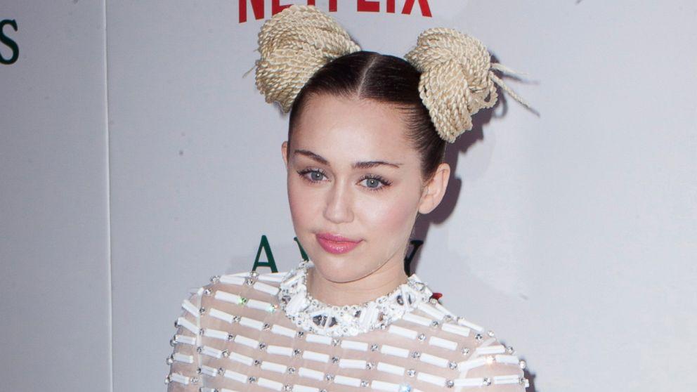 Miley Cyrus Rocks Liam 'Hemsworth' T-Shirt, Fuels Engagement Rumors - ABC News