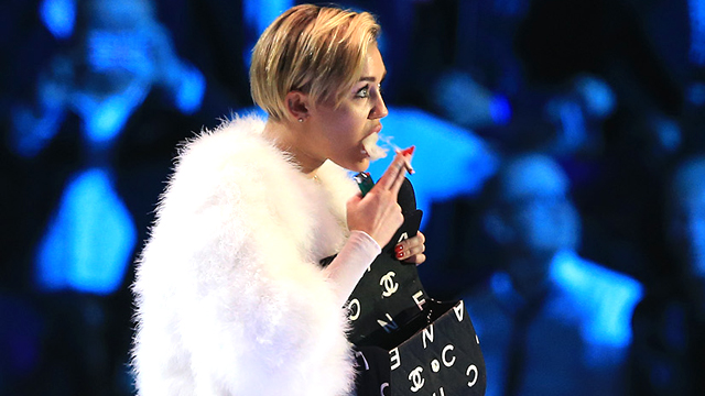 PHOTO: Miley Cyrus smokes onstage at the MTV EMAs in Amsterdam.