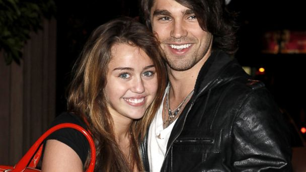 PHOTO: Miley Cyrus and Justin Gaston visit Nubu, March 9, 2009, in West Hollywood, Calif.