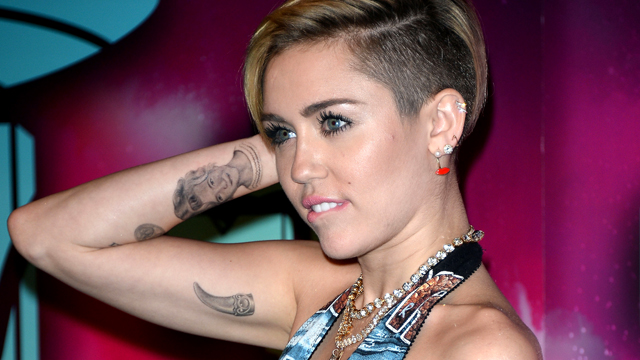 PHOTO: Miley Cyrus shows off her tattoos.