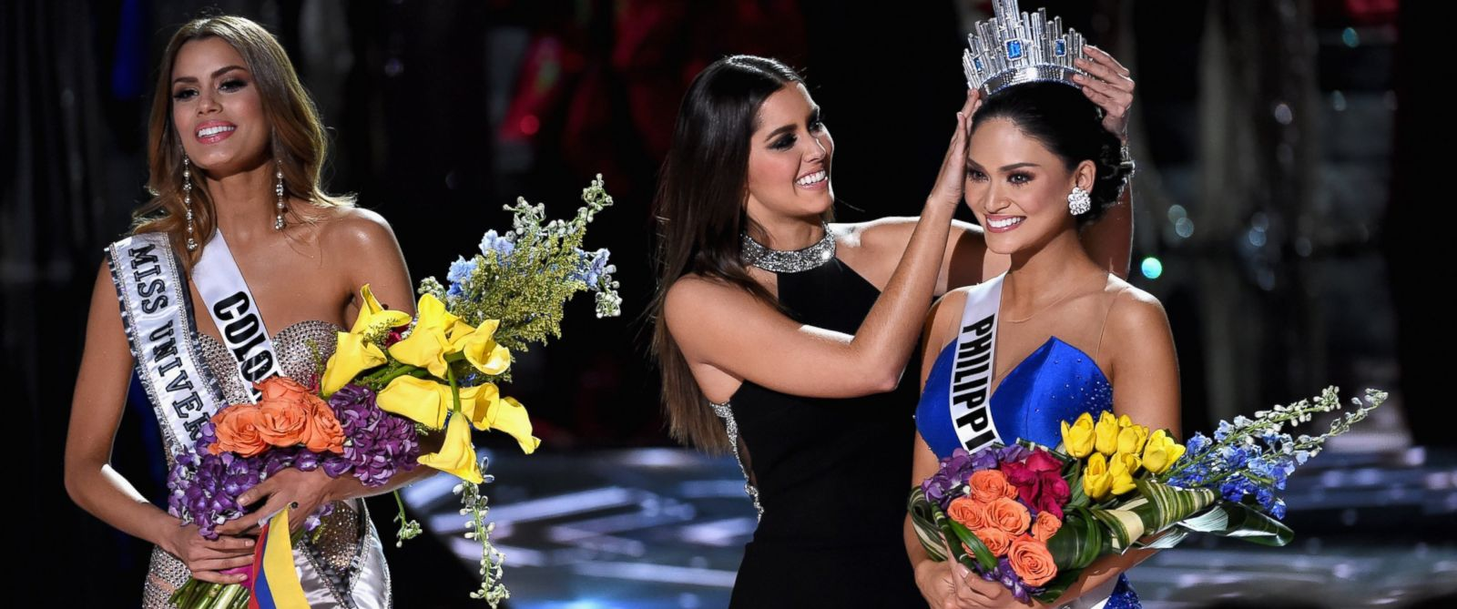 PHOTO:Miss Colombia 2015, Ariadna Gutierrez Arevalo, looks on as Miss Universe 2014 Paulina Vega crowns Miss Philippines 2015, Pia Alonzo Wurtzbach, the new Miss Universe during the 2015 Miss Universe Pageant , Dec. 20, 2015, in Las Vegas.