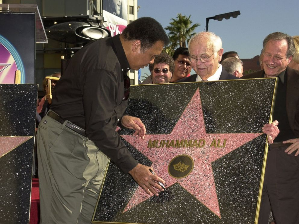 PHOTO:Muhammad Ali signing a replica of his Star on the Hollywood Walk of Fame after a star ceremony for him, Jan. 11, 2002, in Los Angeles.