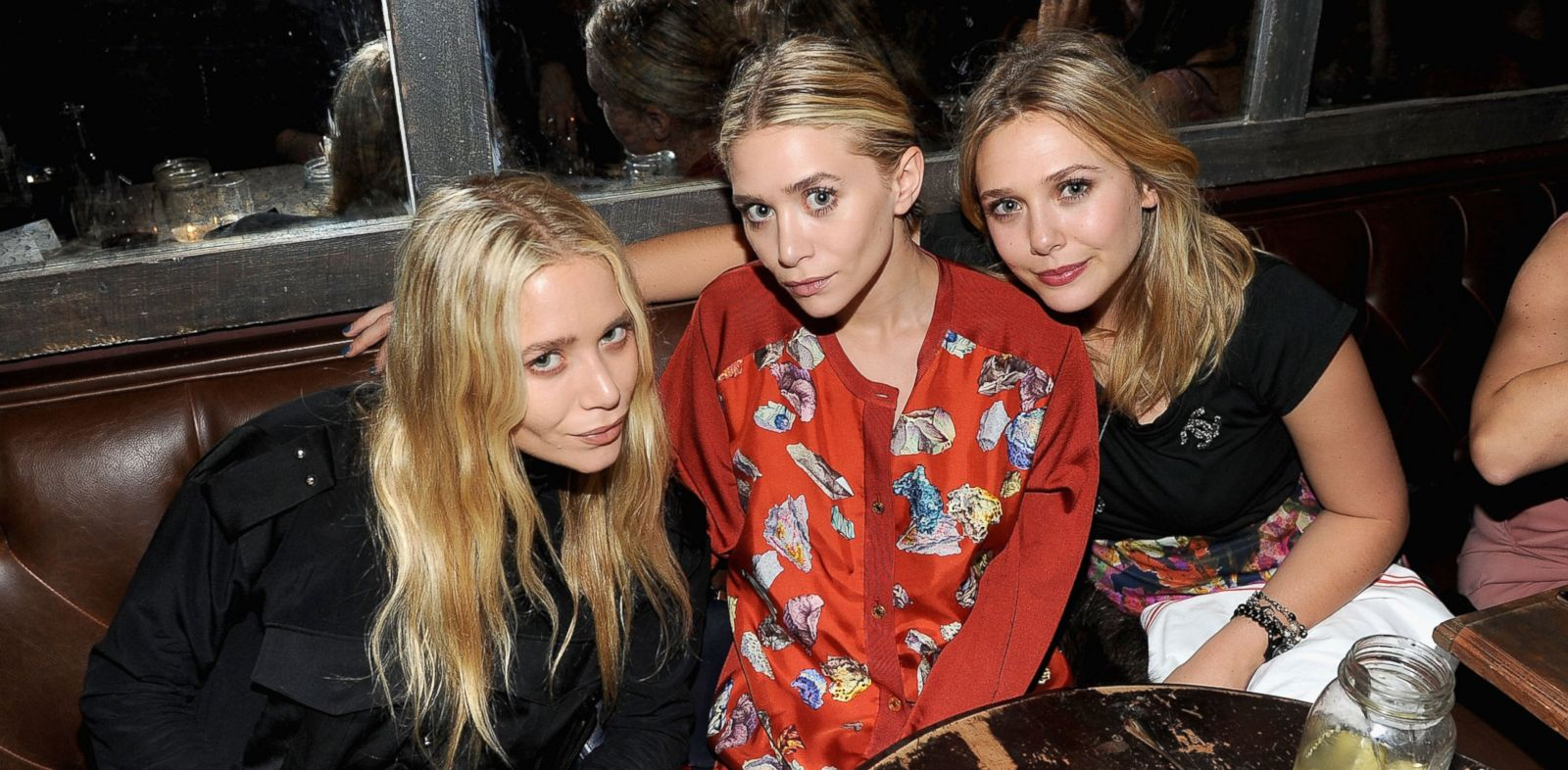 PHOTO: Mary-Kate Olsen, Ashley Olsen and Elizabeth Olsen attend the NYLON & AX Armani Exchange Private Dinner for the October issue with cover star Lizzie Olsen, Oct. 5, 2011 in New York City.
