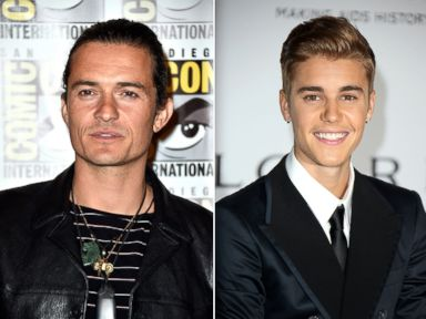 PHOTO: Actor Orlando Bloom is seen during Comic-Con, July 26, 2014 in San Diego, Calif. Right, Justin Bieber attends amfARs 21st Cinema Against AIDS Gala, May 22, 2014 in Cap dAntibes, France.