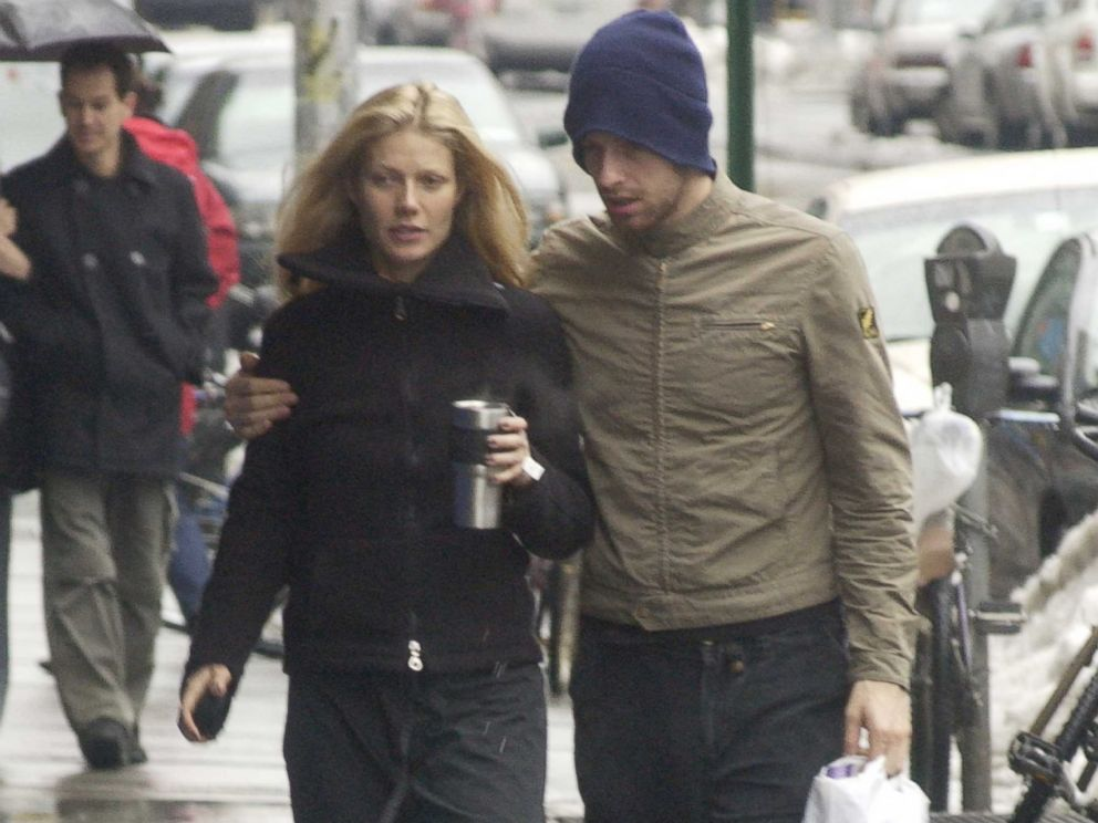 PHOTO: Gwyneth Paltrow, left, walks with Chris Martin, right, on Feb. 23, 2003 in New York City.