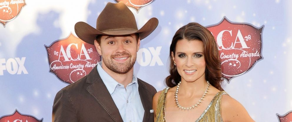 PHOTO: NASCAR drivers Ricky Stenhouse Jr. and Danica Patrick arrive at the American Country Awards 2013, Dec. 10, 2013, in Las Vegas.
