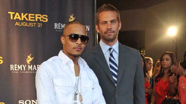 "PHOTO: Rap Artist/Actor Tip T.I. Harris and actor Paul Walker attend the ""Takers"" premiere at Regal Atlantic Station on Aug. 24, 2010 in Atlanta."