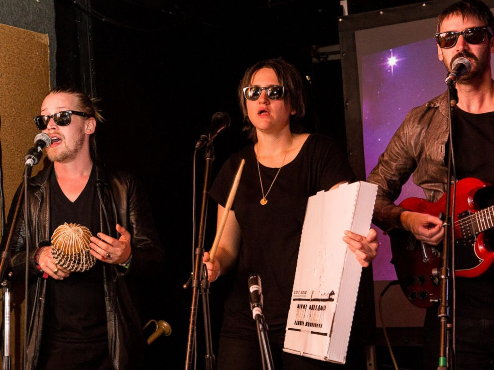 PHOTO: Left to right, Macaulay Culkin, Deenah Vollmer and Matt Colbourn of Pizza Underground perform onstage at The Hi Ho Lounge on March 17, 2014 in New Orleans, Louisiana.