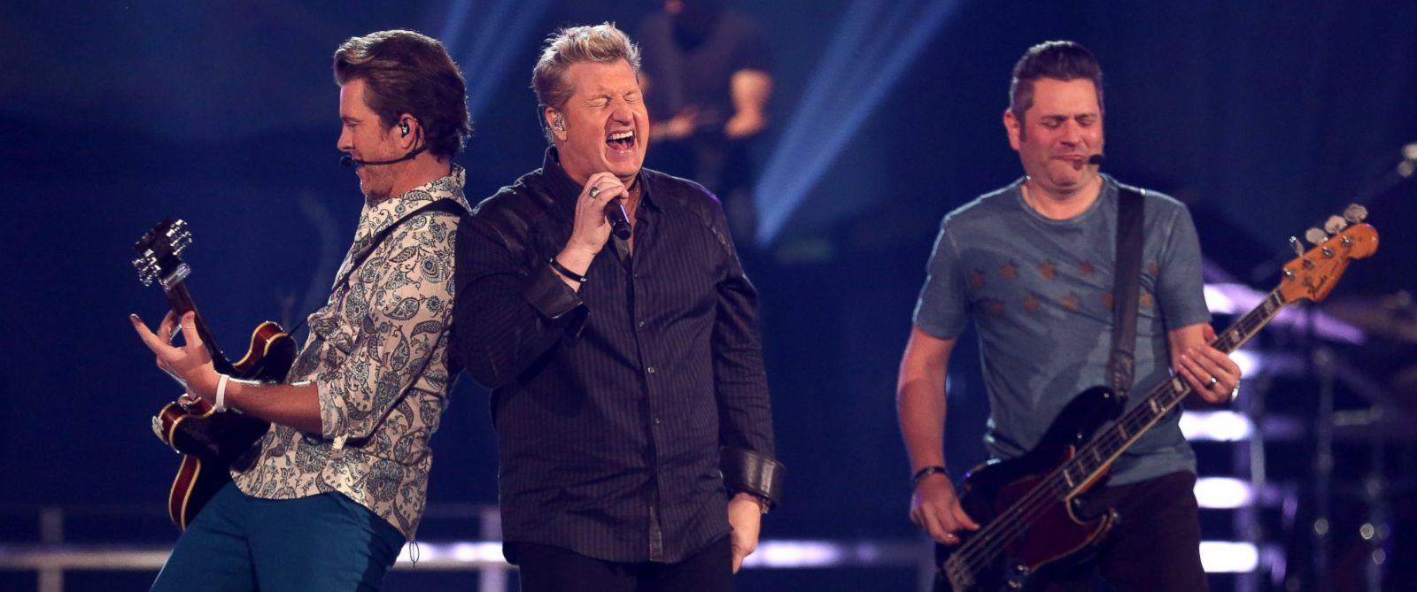 PHOTO: From left, Joe Don Rooney, Gary LeVox and Jay DeMarcus of the band Rascal Flatts perform onstage at the ACM Fan Jam during the 49th Annual Academy of Country Music Awards at the Mandalay Bay Events Center on April 6, 2014 in Las Vegas, Nevada.