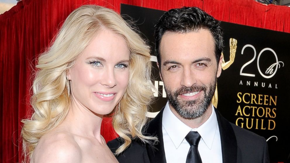 PHOTO: Actor Reid Scott and Elspeth Keller attend the 20th Annual Screen Actors Guild Awards at The Shrine Auditorium on January 18, 2014 in Los Angeles, California.