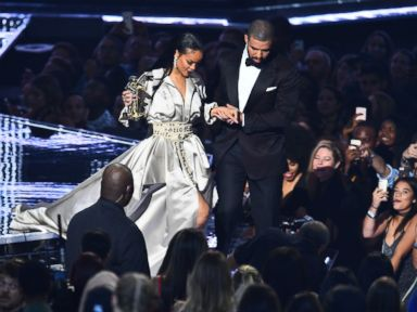 PHOTO: Drake escorts Rihanna after presenting her with The Video Vanguard Award during the 2016 MTV Video Music Awards at the Madison Square Garden in New York, Aug. 28, 2016.