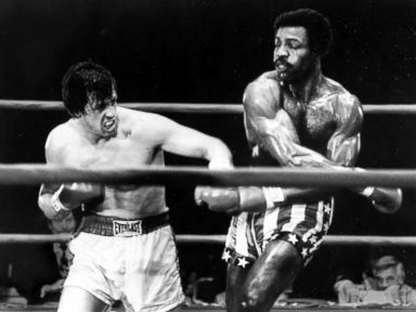 PHOTO: Sylvester Stallone boxes with Carl Weathers in a scene from Rocky.