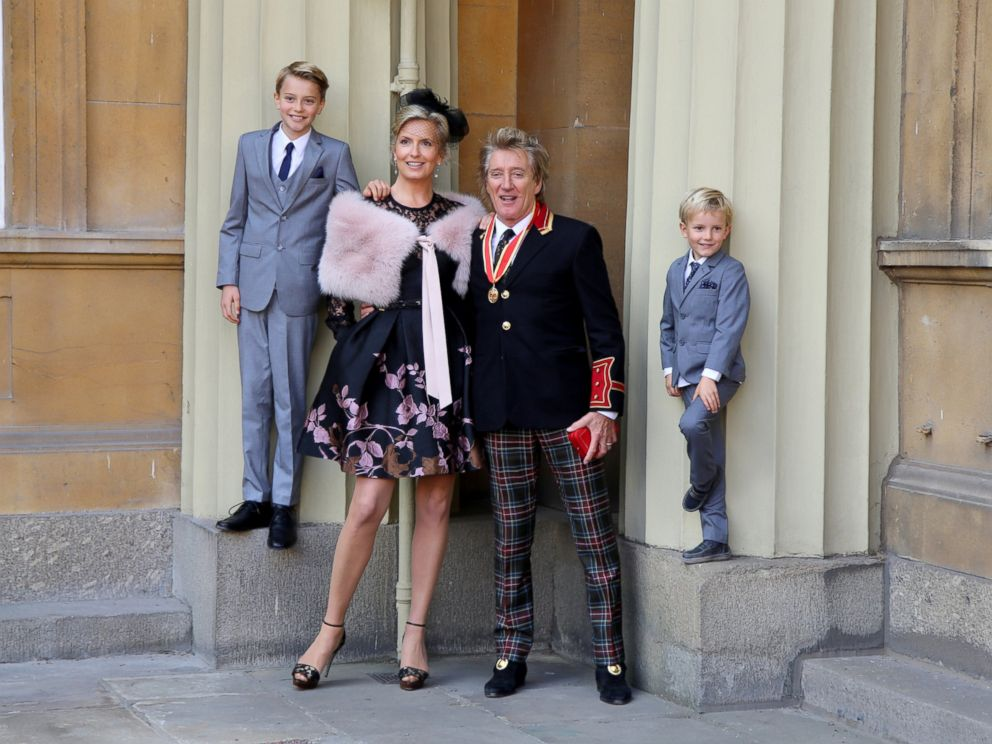PHOTO: Sir Rod Stewart with his wife, Penny Lancaster and children Alastair and Aiden after he received his knighthood in recognition of his services to music and charity at Buckingham Palace, Oct. 11, 2016, in London.