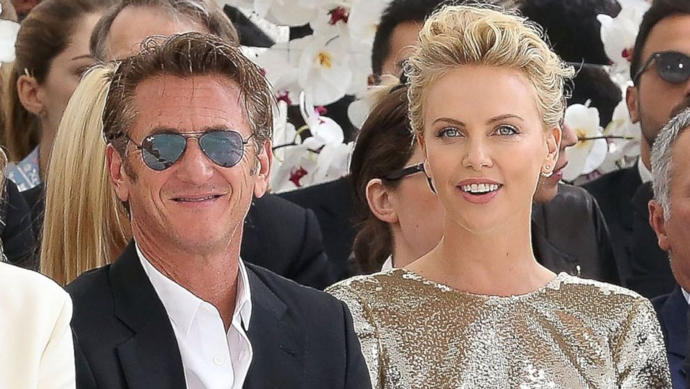 PHOTO: Sean Penn and Charlize Theron attend the Christian Dior show as part of Paris Fashion Week - Haute Couture Fall/Winter 2014-2015 at Muse Rodin, July 7, 2014, in Paris.