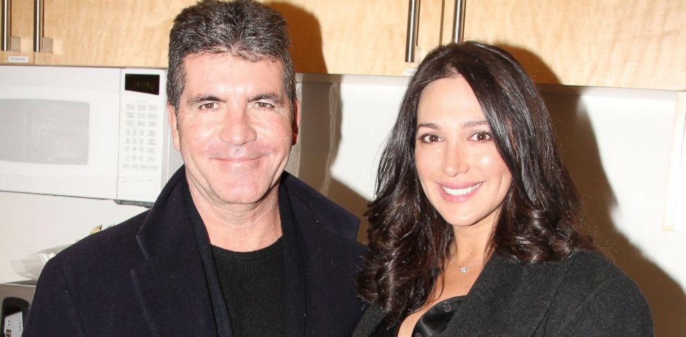 PHOTO: Simon Cowell, left, and partner Lauren Silverman, right, are pictured on Jan. 25, 2014 in New York City.