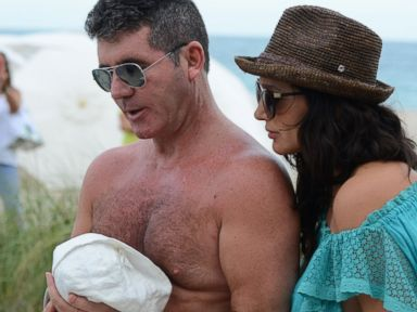 PHOTO: Simon Cowell, left, and Lauren Silverman, right, are seen with their newborn son, Eric Cowell, while at the beach on Feb. 24, 2014 in Miami, Fla.