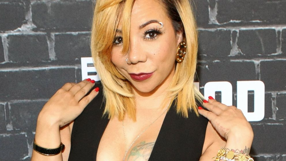 tameka tiny harris gets surgical eye color change abc news - Eye Color Change Surgery Before And After