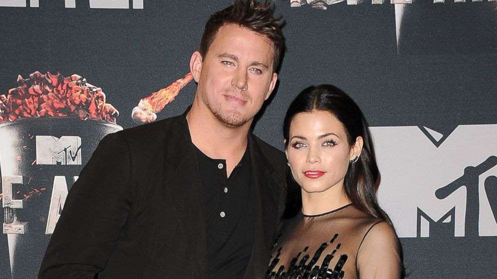PHOTO: Channing Tatum and actress Jenna Dewan-Tatum pose in the press room at the 2014 MTV Movie Awards at Nokia Theatre L.A. Live, April 13, 2014, in Los Angeles.