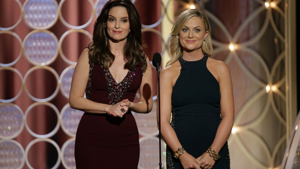 PHOTO: Tina Fey and Amy Poehler speak onstage during the 71st Annual Golden Globe Awards