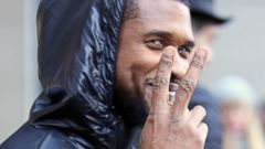Usher Is All Smiles Flashing the Peace Sign