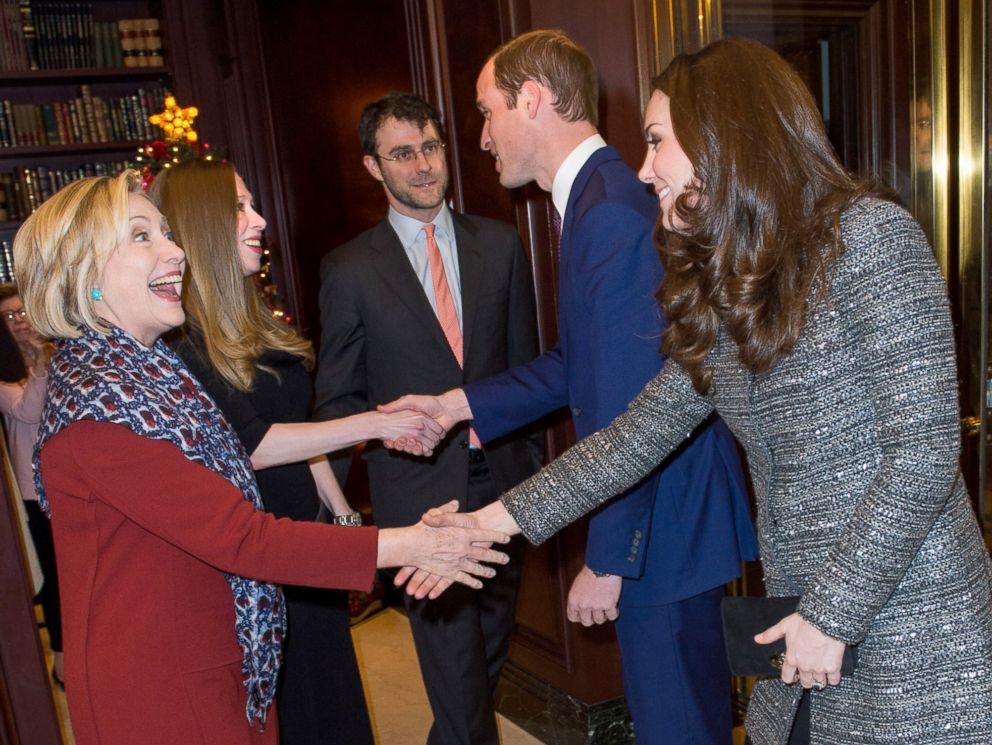 PHOTO: Catherine, Duchess of Cambridge, right, meets former United States Secretary of State, Hillary Clinton as Prince William, Duke of Cambridge meets Chelsea Clinton, Dec. 8, 2014.
