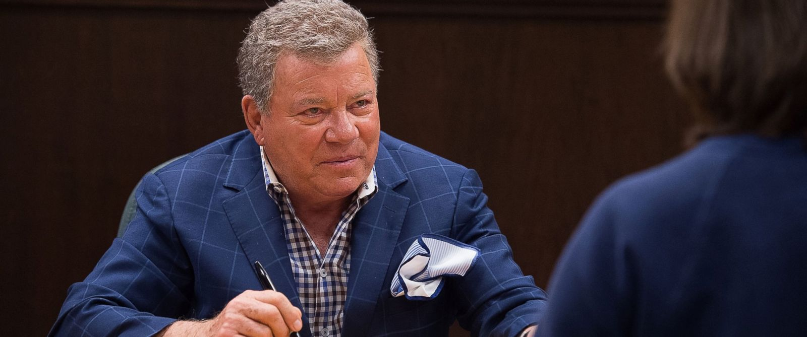 """PHOTO: William Shatner signs his new book """"Leonard: My Fifty-Year Friendship with a Remarkable Man,"""" Feb. 18, 2016 in Los Angeles, California."""